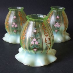 Set of three Vaseline lamp shades with hand painted floral motif (c.1900)
